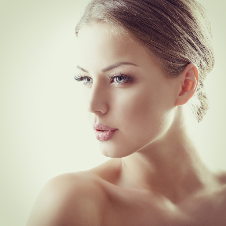 Beauty portrait of young woman with beautiful healthy face, stud